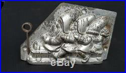 Antique Chocolate Mold 3 Dwarfs (or Santa Claus) with an Angel on a Sled