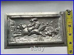 Antique chocolate mold rabbit riding dog
