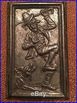 Rare antique Anton Reiche postcard chocolate mold dog chasing man